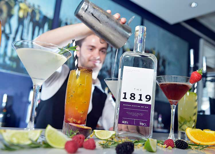Apex Waterloo Place Hotel bartender, Oscar Maestre, with the limited edition gin 'The 1819'