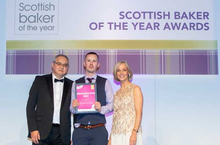 Gary McAllister of The Bread Guys Bakery (centre)collecting his award from Norman Lack of Rondo (left) and Mich Turner MBE (right)